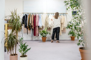 conscious shopping in clothing store and make a change shop less